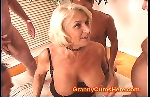 Granny receives a pack rumble coupled with cum bath