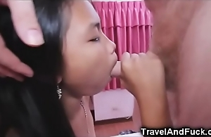 Consolidated oriental legal age teenager creampied wits a tourist!