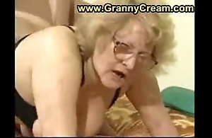 Obese granny at hand glasses